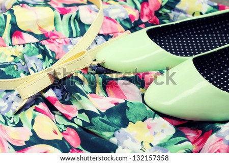 Green shoes and belt on the dress - stock photo