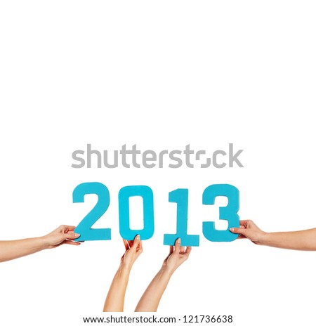 2013 greeting card with blue numerals held up by female hands isolated against a white background with copyspace for your New Year greeting - stock photo