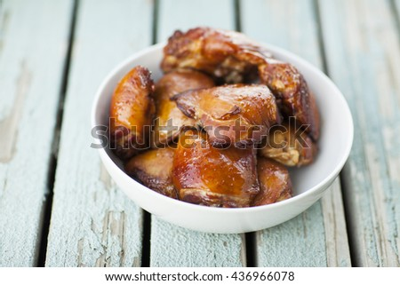 grilled chicken wings on a white dish - stock photo