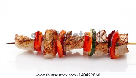 grilled pork fillet and vegetables on white background, pork barbecue - stock photo