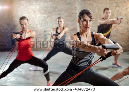group exercising with a resistance band