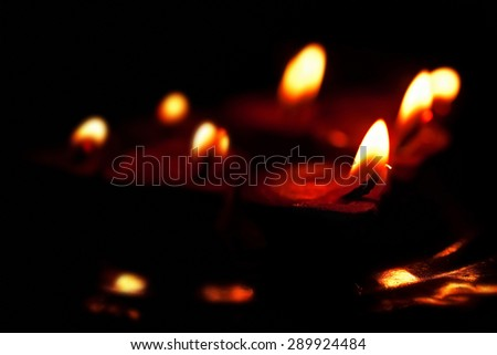 Group of burning candles in the dark