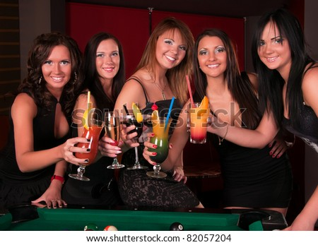 Group of happy girls drinking cocktails - stock photo