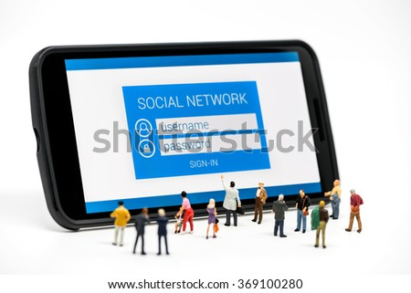 Group of people watching at social network sign in page on smartphone. Macro photo - stock photo