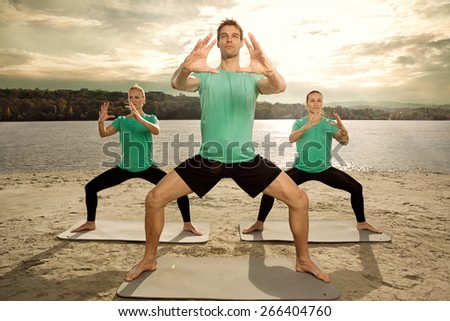 Group of young people having yoga class, outdoor - stock photo