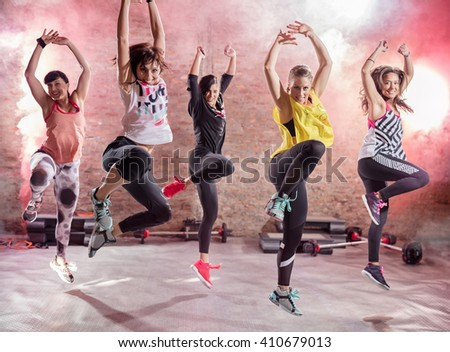 Group of young women  dancing, fun and exercising
