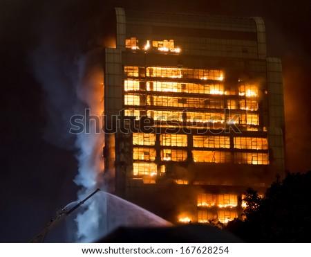 15/12/2013  Guangzhou China building on fire / big fires /news - stock photo