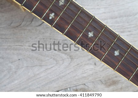 guitar on old wood background - stock photo