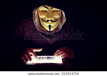 hacker with mask work to close terrorist sites - stock photo