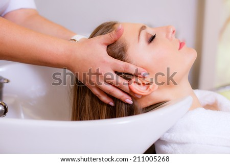 Hairdresser girl washing her hair,   health and beauty hair - stock photo
