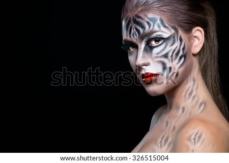 Halloween make up. Woman with tiger face in halloween concept. Halloween make up - stock photo