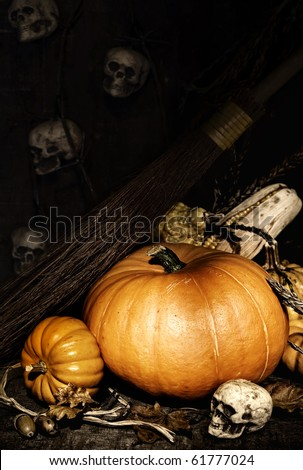 Halloween scene of a pumpkins, skulls and  witch broomstick - stock photo
