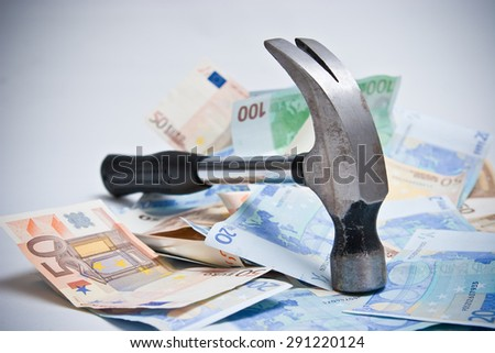 Hammer and paper money - stock photo