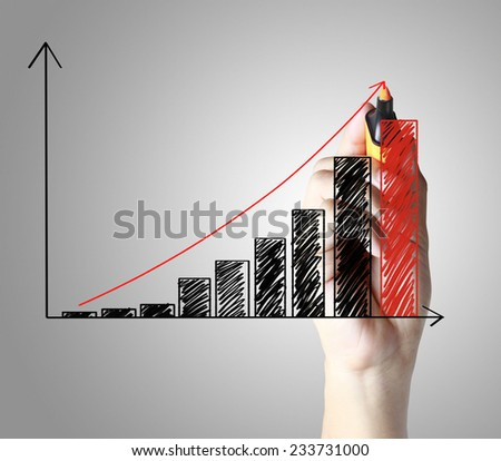 hand drawing a graph  - stock photo