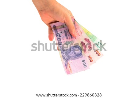 hand holding thailand paper currency from the top isolated on white