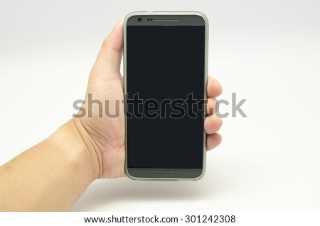 Hand holding the smartphone - stock photo