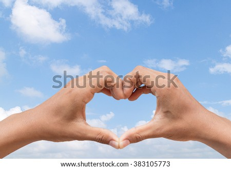 hand in heart shape show love friendship on blue sky background
