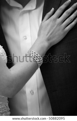 hand of bride on groom - stock photo