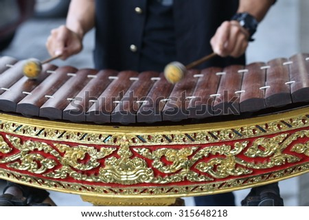 hand play concert Thailand wood Alto xylophone ,Thai alto xylophone Asia music instrument, traditional culture and song music of Asia.  - stock photo