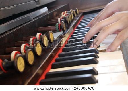 hand play vintage piano - stock photo