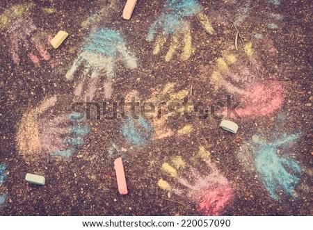 hand prints on pavement - stock photo