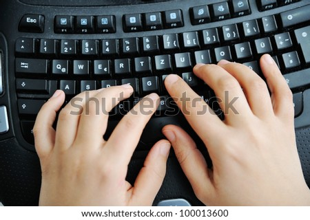Hand typing on keyboard - stock photo
