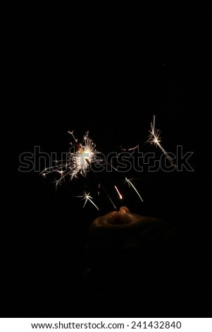 Hand with firework  - stock photo