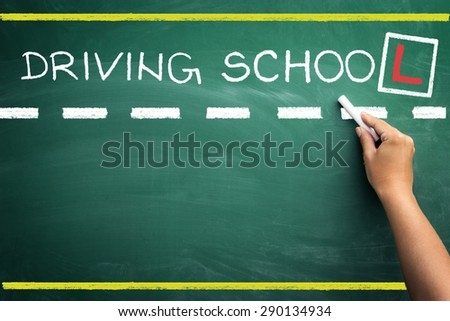 hand writing driving school on black chalkboard  - stock photo