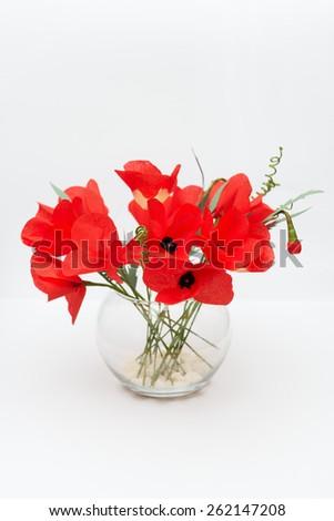 handmade paper flower in flowerpot - stock photo