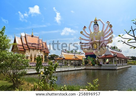 18 hands God statue (Guanyin) on blue sky in temple (Wat Plai Laem),Koh Samui,Surat Thani,Thailand