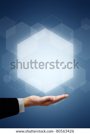?Hands of business man have Hexagon above on blue background - stock photo