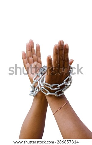 hands tied a metal chain on a white background - stock photo