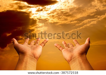 hands to pray or hope in Gold sky and sun shine heaven - stock photo