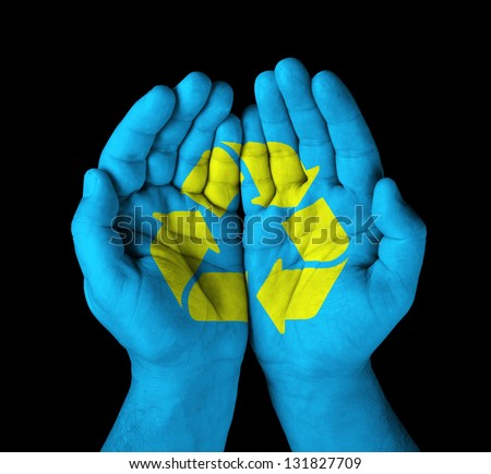 hands with painted recycle symbol