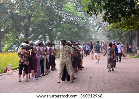 Hanoi, Vietnam - October 25, 2015: People exercising in park in the morning in Hanoi, Vietnam. - stock photo