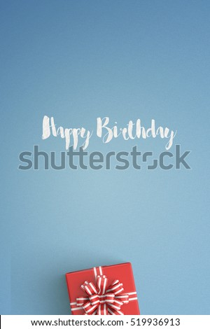 happy birthday gift boxes with red ribbons viewed from top isolated