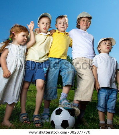 happy boy and girl play in soccer - stock photo