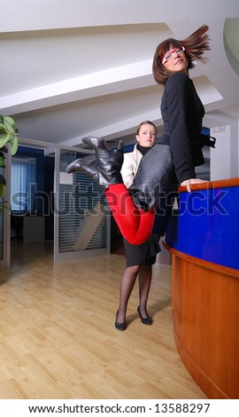 .happy businesswoman jumping in office