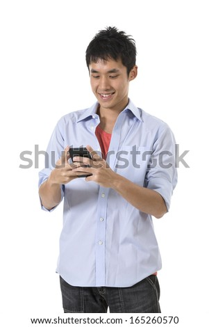 Happy Chinese man using a smartphone. Isolated against white background. - stock photo