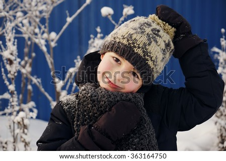 Happy cute boy walking outside,close up portrait