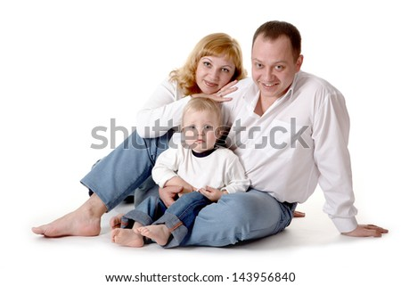 happy family/Father, mother and son looking into the camera. Studio shot, white background - stock photo