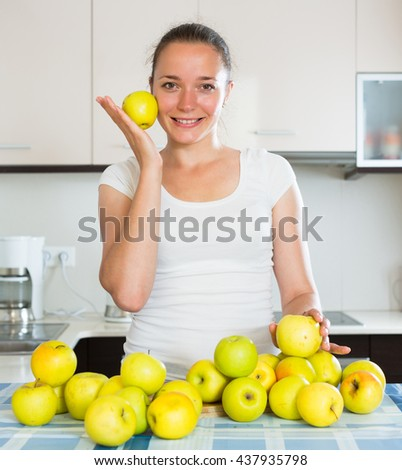 happy girl prepares healthy food in the kitchen