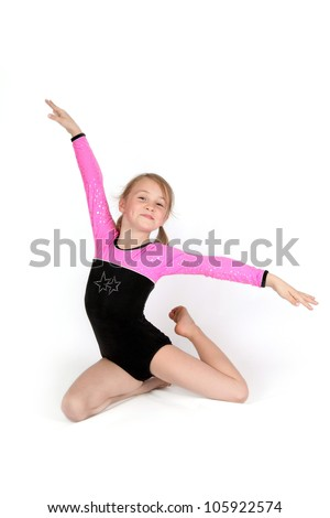 Happy gymnastic girl in sitting pose, isolated on white - stock photo
