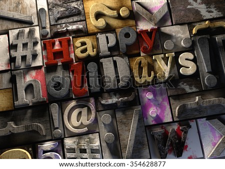 #Happy Holidays! on retro wooden print blocks celebrating the holidays of the festive season and vacations. A title on wooden ink splattered printing blocks. Grungy typography textured background.