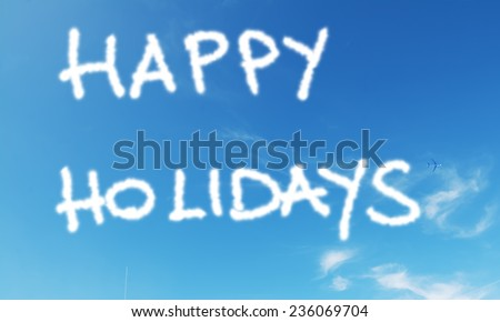 """""""happy holidays"""" written in the blue sky - stock photo"""