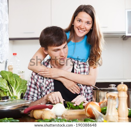 Happy loving couple cooking together
