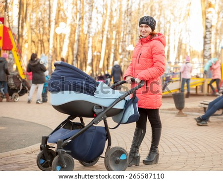 Happy mother with   small child in   park. - stock photo