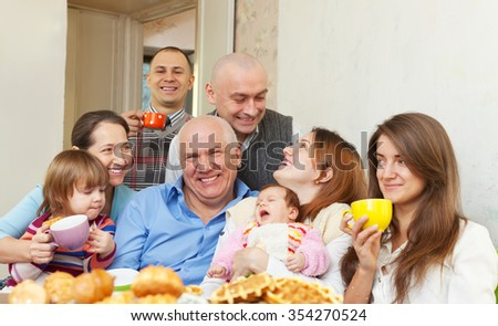 happy multigeneration family with little baby at home