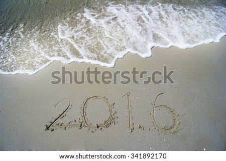 Happy New Year 2016 concept on the sea beach - stock photo