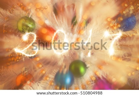 Happy new year 2017 writing sparkles firework with christmas defocused light bokeh background